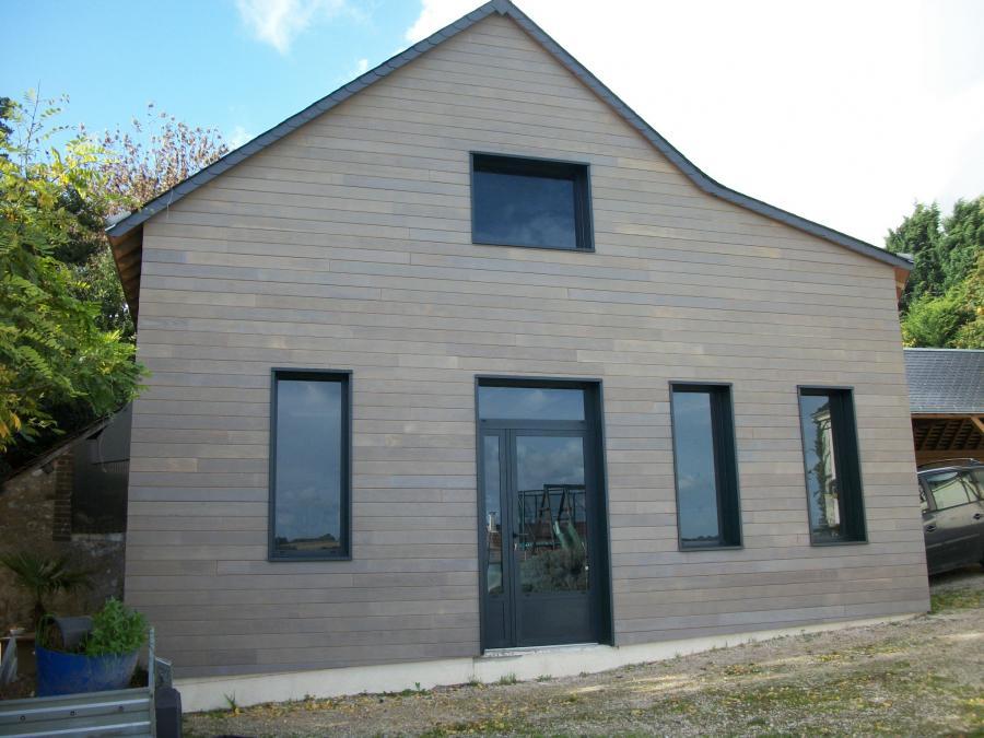 Façade du bâtiment après pose de bardage bois