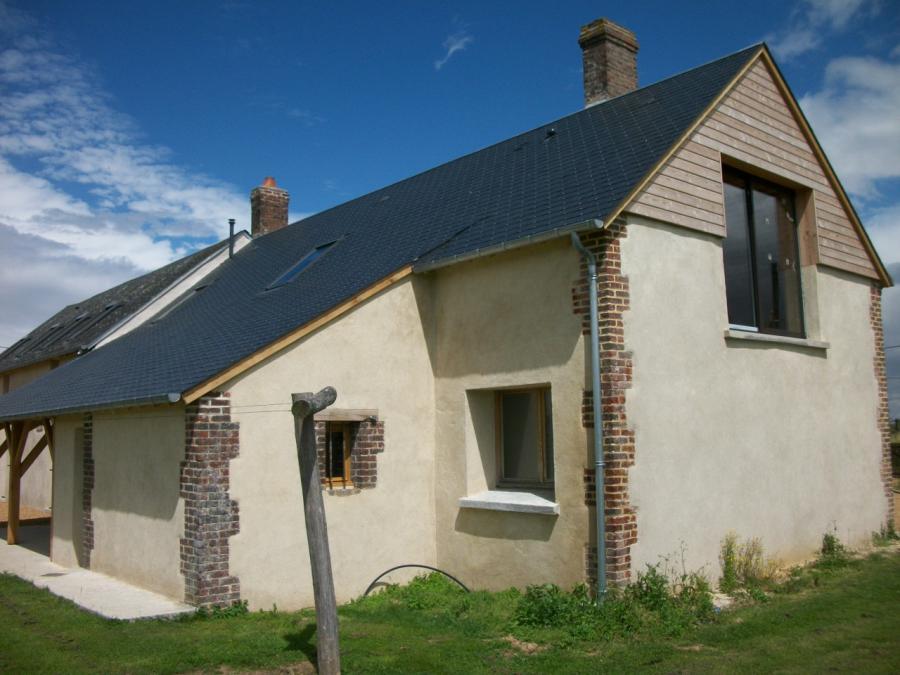 Maison après travaux de rénovation de la charpente avec modification du pignon